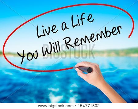 Woman Hand Writing Live A Life You Will Remember With A Marker Over Transparent Board