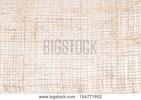 blurred burlap or jute open woven texture background. Defocussed.