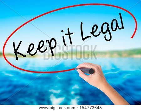 Woman Hand Writing Keep It Legal With A Marker Over Transparent Board