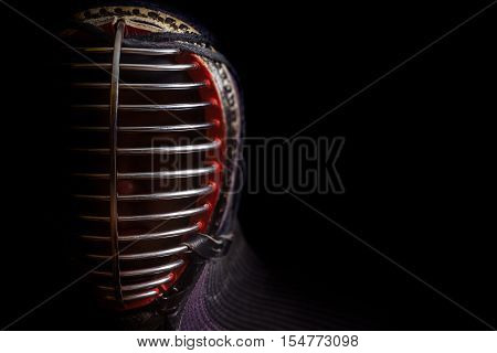 Head shot of kendoka on the black background