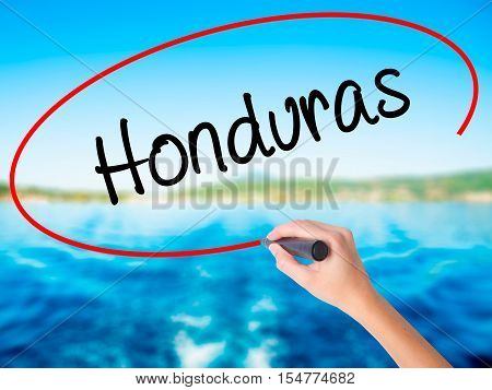Woman Hand Writing Honduras With A Marker Over Transparent Board