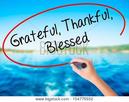Woman Hand Writing  Grateful Thankful Blessed With A Marker Over Transparent Board