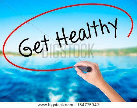 Woman Hand Writing Get Healthy With A Marker Over Transparent Board