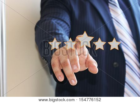 Business key rating increase icon.The concept of evaluation. Businessman pointing five stars to increase the rating company, the rating increase.