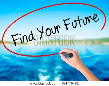 Woman Hand Writing Find Your Future With A Marker Over Transparent Board