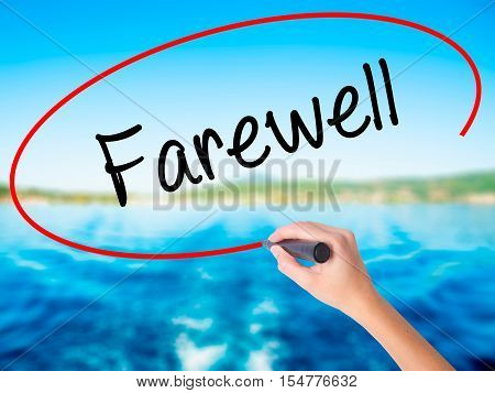 Woman Hand Writing Farewell  With A Marker Over Transparent Board
