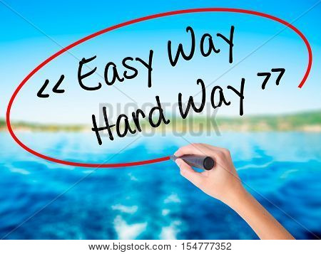 Woman Hand Writing Easy Way - Hard Way With A Marker Over Transparent Board.
