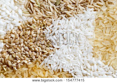 Abstract Pattern Made Of White, Brown And Parboiled Rice From Above.