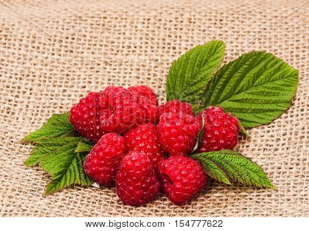 raspberry and burlap cloth. Food  background ,