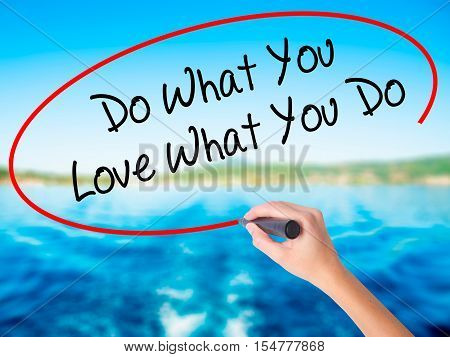 Woman Hand Writing Do What You Love What You Do With A Marker Over Transparent Board