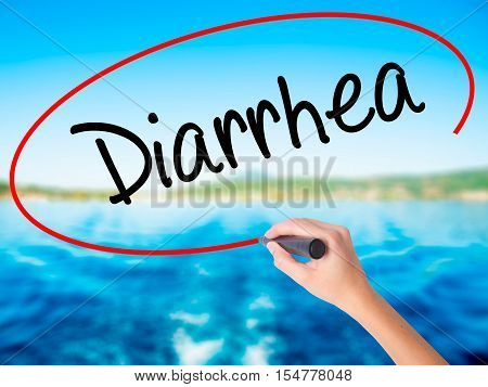 Woman Hand Writing  Diarrhea  With A Marker Over Transparent Board