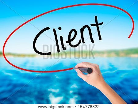 Woman Hand Writing Client  With A Marker Over Transparent Board