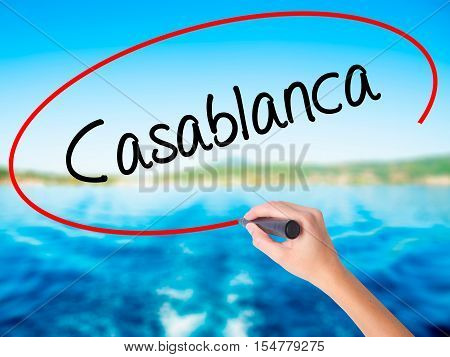 Woman Hand Writing Casablanca With A Marker Over Transparent Board
