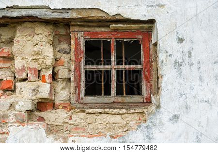Small window in an old ruinous house.