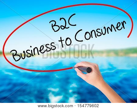 Woman Hand Writing B2C Business To Consumer With A Marker Over Transparent Board