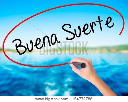 Woman Hand Writing Buena Suerte( Good Luck In Spanish) With A Marker Over Transparent Board