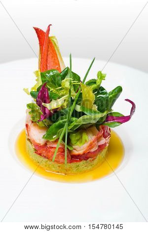 Exclusive restaurant food, haute cuisine. Crab meat appetizer closeup on white plate. Seafood delicacy