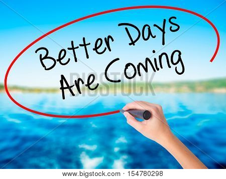 Woman Hand Writing Better Days Are Coming With A Marker Over Transparent Board.