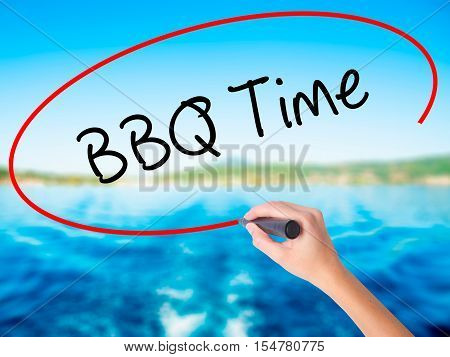 Woman Hand Writing Bbq Time With A Marker Over Transparent Board
