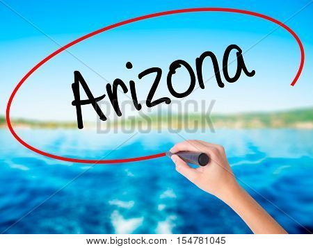 Woman Hand Writing  Arizona  With A Marker Over Transparent Board