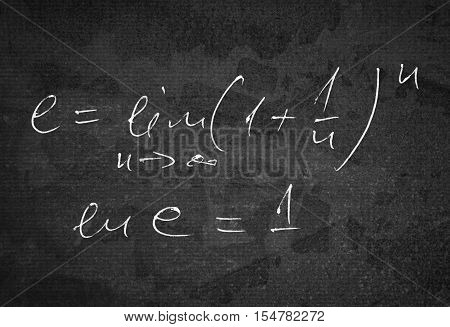 Number e which is a base of natural logarithm as a limit of infinite serie