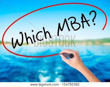 Woman Hand Writing Which Mba? With A Marker Over Transparent Board