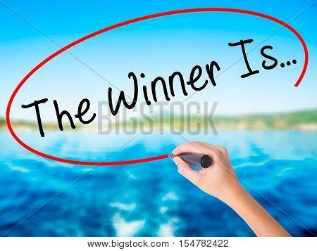 Woman Hand Writing The Winner Is
