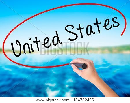 Woman Hand Writing United States With A Marker Over Transparent Board