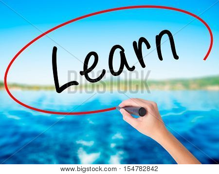 Woman Hand Writing Learn With A Marker Over Transparent Board