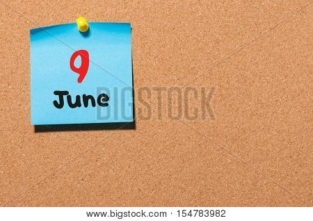 June 9th. Day 9 of month, color sticker calendar on notice board. Summer time. Empty space for text.