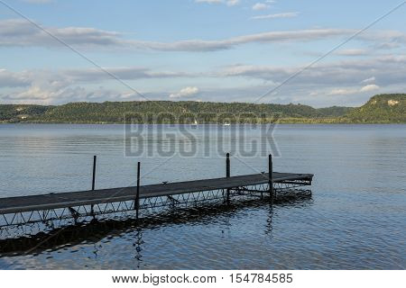 A Mississippi River scenic in early autumn with a boat dock.