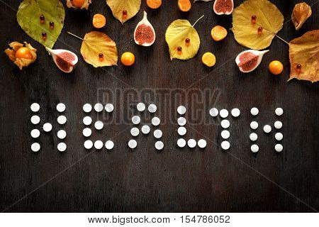 concept health - treatment with hot tea and medecine on wooden background
