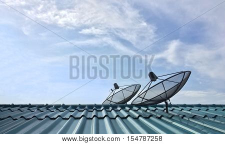 Two satellite dish receive signals from another station in space is part of Satellite communication systems for mobile phone, TV channel, Internet and other dish of households on rooftop