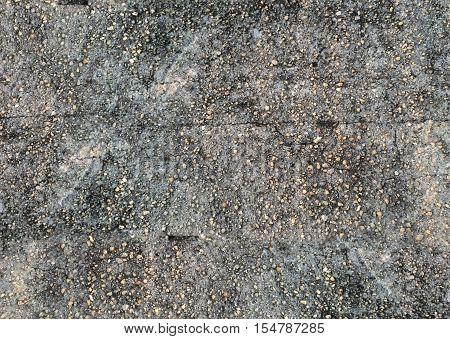 Dark granite stones concrete texture background.Abstract street style