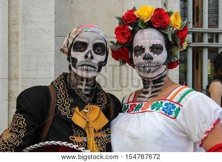 Couple In Tradicional Skull Costume In Zombie Walk Sao Paulo