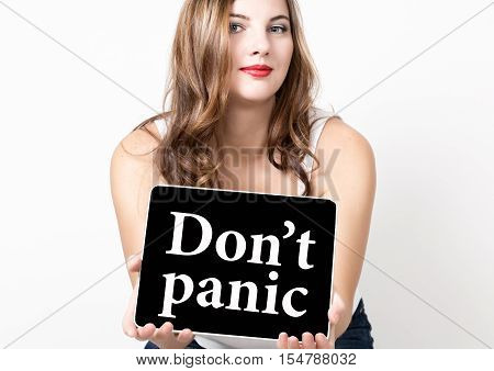 don't panic written on virtual screen. technology, internet and networking concept. beautiful woman with bare shoulders holding pc tablet.