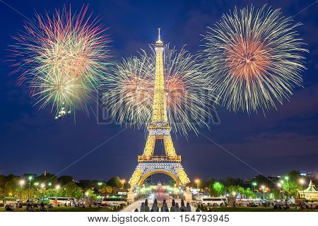 PARIS FRANCE - May 8 2016: Eiffel tower light performance show and New Year 2017 firewors in night. The Eiffel tower is the most visited monument of Paris France.