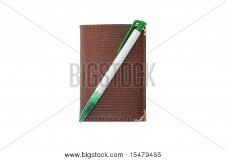 Traditional paper notebook and ballpoint isolated on white