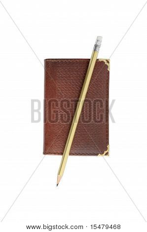 Traditional paper notebook and pencil isolated on white