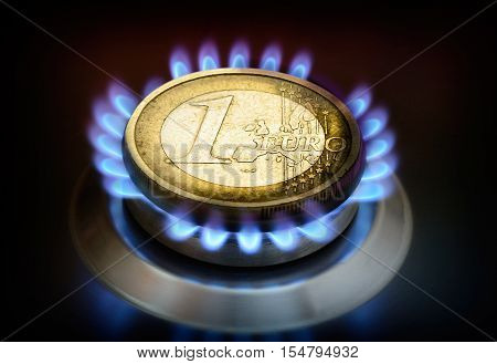 Euro crisis, energy costs. Coin one euro on a gas torch.