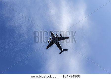 a fighting military plane in the sky