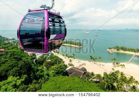 Singapore cable car in Sentosa island with aerial view of Sentosa island in Singapore.