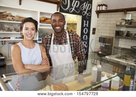 Mixed race couple behind the counter at a sandwich bar