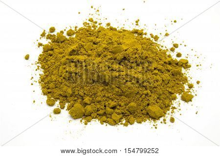 Pile of curry powder on white isolated background