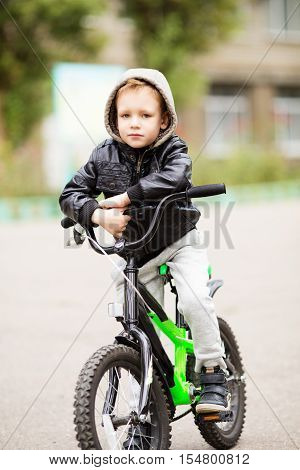 The Boy Learns To Ride A Bike.