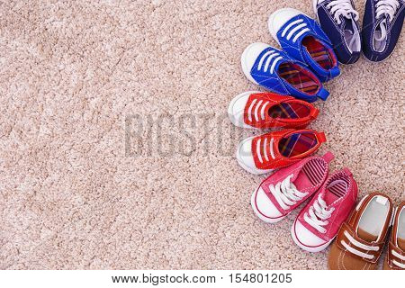 Colorful kids shoes on floor