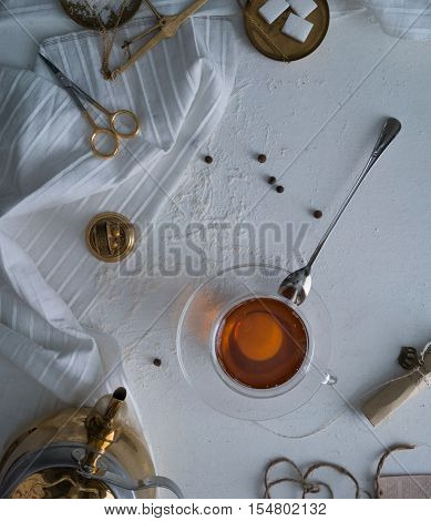 tea, scales, candles, letter on the table space for text