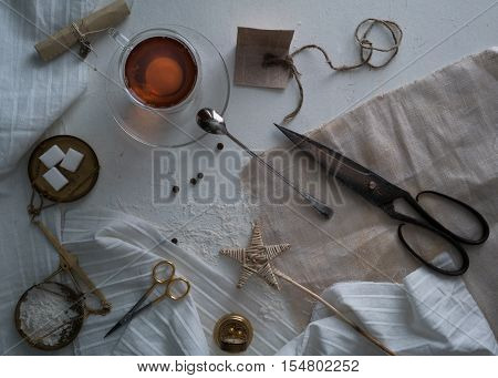 tea, scales, candles, scissors, letter on the table space for text