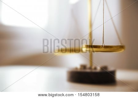 Justice scales on table in the room