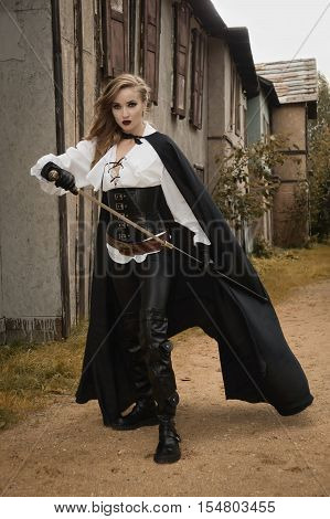 Sexy Woman In Pirate Style Holding Sword